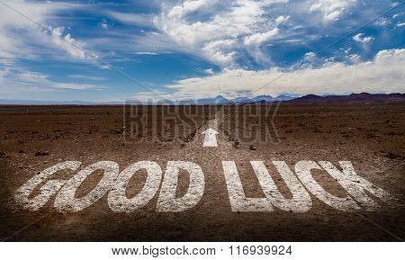 Good Luck written on desert road