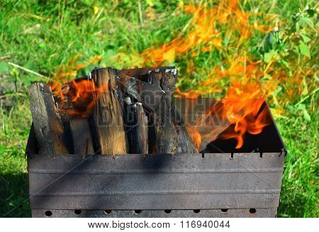 burning wood in a brazier on picnic