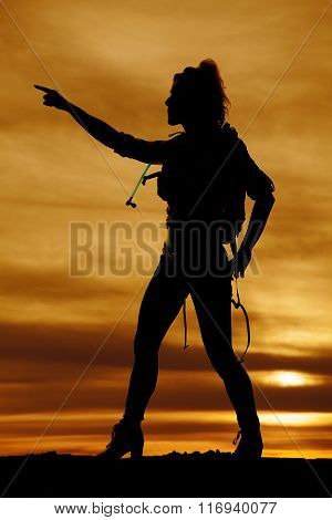 Silhouette Of A Woman Hiker Pointing In The Sunset