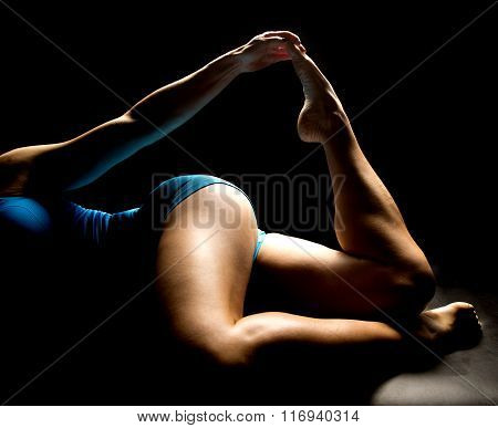 Woman In Blue Shorts Lay Legs Forward Toe Up Highlighted