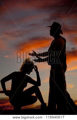 Silhouette Of Blonde Woman Crouch Hand On Head Cowboy