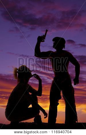 Silhouette Of A Blonde Woman Crouch Look Up At Cowboy