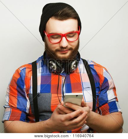 young bearded man with  mobile