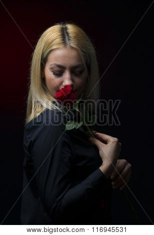 Portrait Of A Beautiful Blonde Girl Smelling A Red Rose Solated