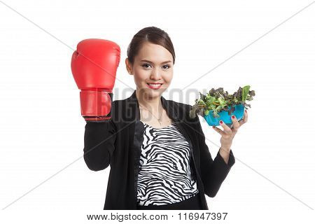 Young Asian Business Woman With Boxing Glove And Salad