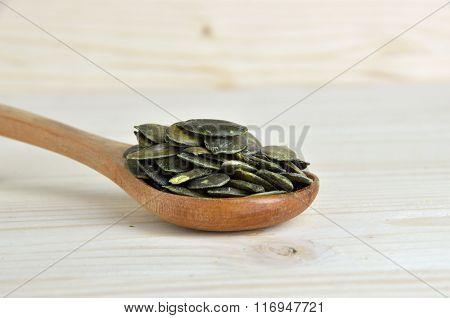 Wooden Spoon Full Of Pumpkin Seeds