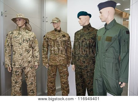 Men Mannequins In Uniform. Army And Gear