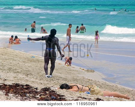 Black Man In Swimsuit At The Beach