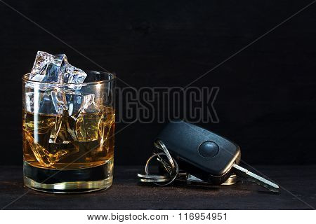 Whiskey Glass And Car Keys On Dark Rustic Wood, Concept Alcohol And Driving