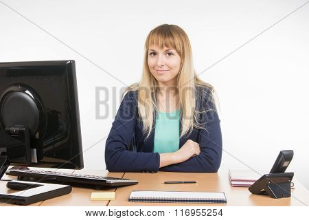 The Secretary At His Workplace In The Office