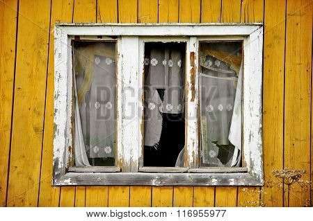 Wooden House With Broken Windows