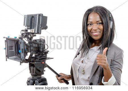 Young African American Woman With Professional Video Camera And Headphone