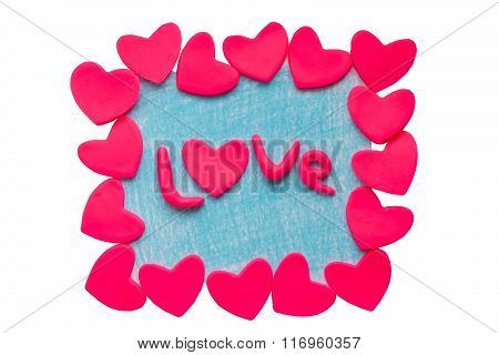 Valentine's card with clay hearts and the word