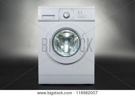 Washing Machine Over Gray Background