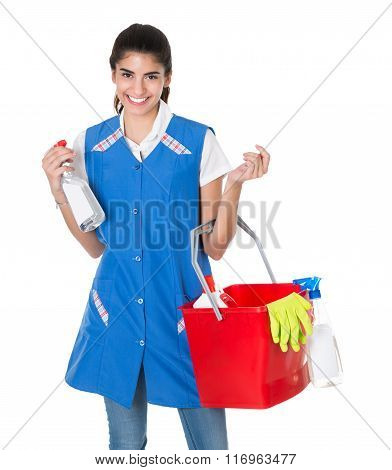 Happy Female Worker Carrying Bucket With Cleaning Equipment