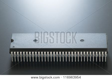 The microprocessor in the DIP on black backround