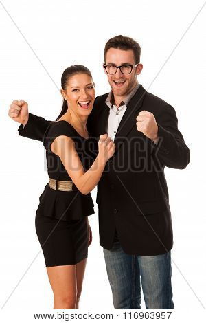 Business Couple Celebrating Success Holding Fists And Screaming Of Joy. Team Work Conceptual Image.
