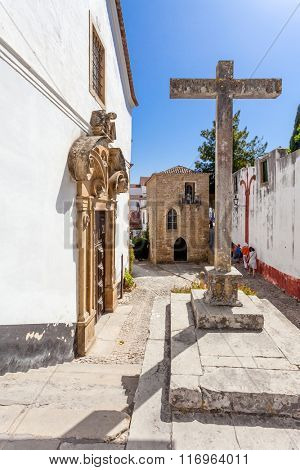Obidos, Portugal. Misericordia Church with the Medieval Sephardic Synagogue in background. Obidos is a medieval town inside walls, and very popular among tourists.