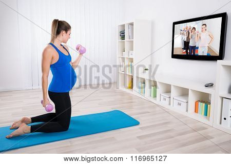 Pregnant Woman Doing Exercise With Dumbbells