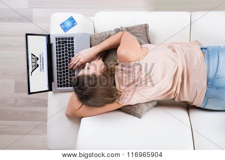 Woman Sleeping While Shopping Online