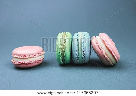 Colorful macarons on retro background