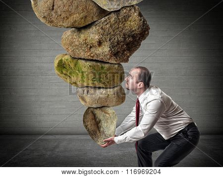 man lift lots of huge stones