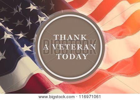 Text Thank A Veteran Today in round frame on American flag background