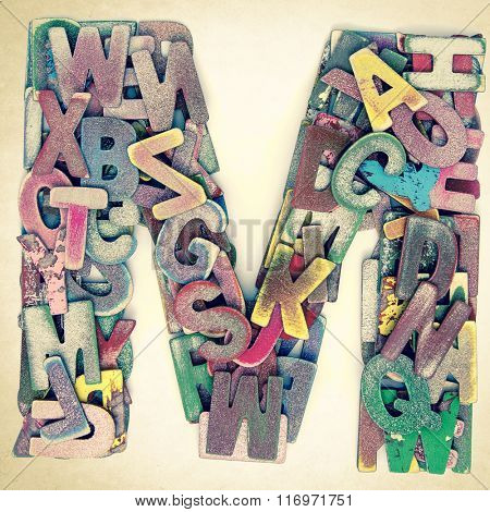 Wooden letters made from lots of small painted letters