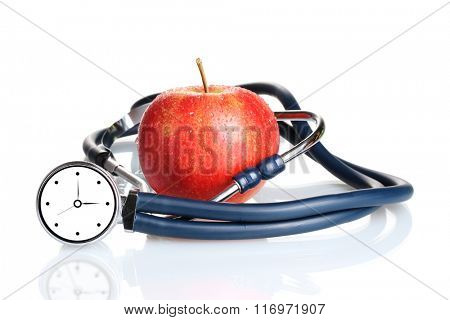 Medical stethoscope with clock and red apple isolated on white