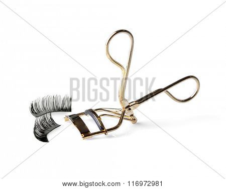 Curler and false eyelashes, isolated on white