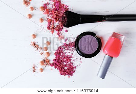 Makeup brush and cosmetics on white background