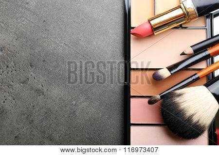 Cosmetics on dark background