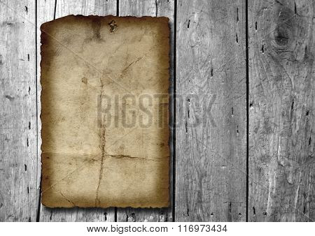 Vintage old grungy paper banner over ancient wood texture background