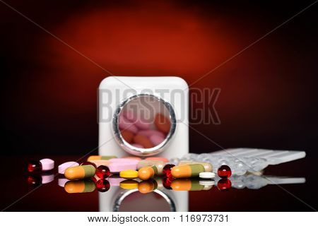 various pills against dark background
