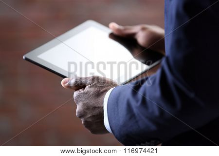 Male hands with tablet, close up