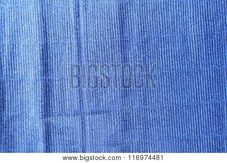 Blue cloth texture with uneven crumpled surface