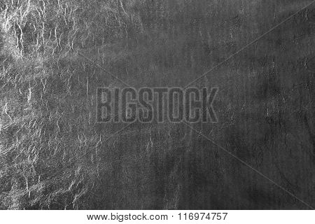 Silver foil texture with crumpled uneven surface