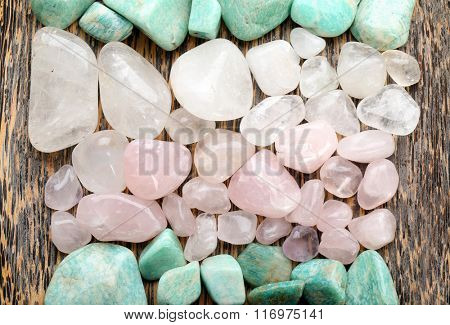 Semiprecious stones on wooden background