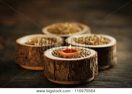 Burning wooden candle with sea salt, closeup