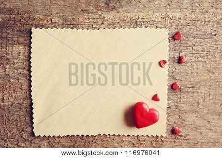 Blank present Valentine card on wooden background