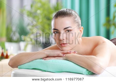 Woman ready for spa massage at beauty spa salon