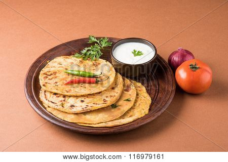 Traditional Indian bread - Aloo paratha or aalu parotha, potato stuffed bread. served with tomato ke