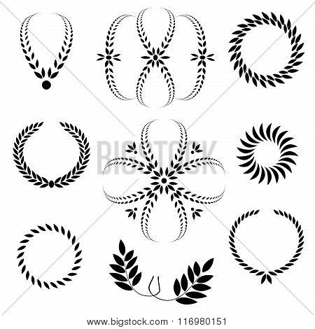 Laurel wreath tattoo set. Black stylized ornaments. Cross, circle, wing signs on white background. V