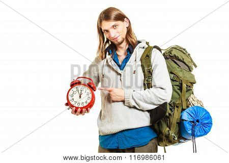 Travel Time Season. Man Backpacker Holding Clock.