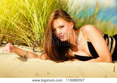 Woman Face Sunbathing On Beach.