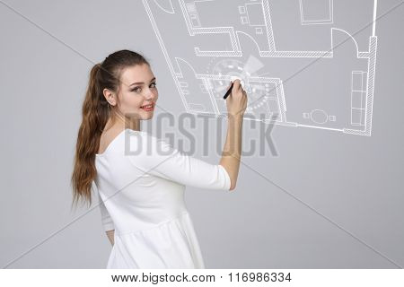 young woman with pen on grey background
