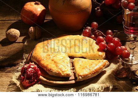 Pie With Cheese And Oil, Fruit, A Walnut And Red Wine