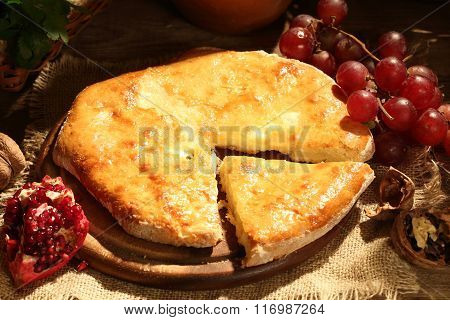 Pie With Cheese Submitted With Nuts And A Pomegranate