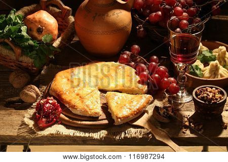 Red Wine Submitted With Fruit, Nuts And A Cheese Pie