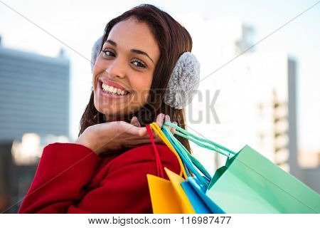 Women holding some shopping bags outside